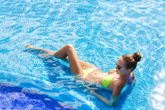 Beautiful woman with sexy body by the pool Royalty Free Stock Photos