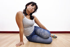 Beautiful woman sexy leggings grey top on the floor Stock Image