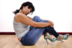 Beautiful woman sexy leggings grey top high heels Royalty Free Stock Image