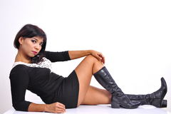 Beautiful woman sexy mini dress black boots Stock Photography