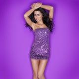 Beautiful woman in sexy purple miniskirt Royalty Free Stock Photo