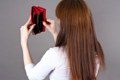 Woman shakes out the last of the purse Royalty Free Stock Photography