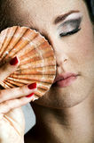 Beautiful woman with a shell Stock Photos