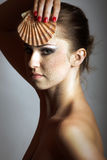 Beautiful woman with a shell Stock Photography