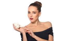 Beautiful woman with shell in hand on white background Royalty Free Stock Photography
