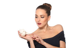 Beautiful woman with shell in hand on white background Royalty Free Stock Photo