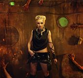 Beautiful woman in a shelter. Woman in a bunker with zombie hands around her Stock Images
