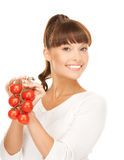 Beautiful woman with shiny tomatoes Royalty Free Stock Photo
