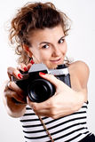 Beautiful woman in a shirt with camera Royalty Free Stock Image