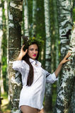 Beautiful woman in shirt standing near the birches Stock Photography