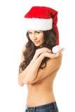 Beautiful woman shirtless wearing santa claus hat, looking at the camera Stock Photography