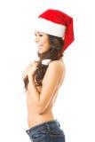 Beautiful woman shirtless wearing santa claus hat Stock Images