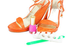 Beautiful woman shoes with make up tools Royalty Free Stock Photos