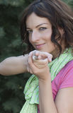 Beautiful woman shooting with hand Stock Photography