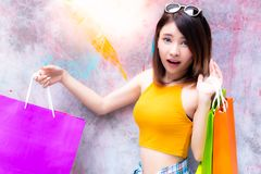 Beautiful woman is shopaholic. Gorgeous woman can not restrain, royalty free stock images