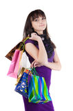 Beautiful woman with shoping bags. Isolated over white background stock image