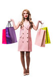 Beautiful woman with shoping bags over white background Stock Photo