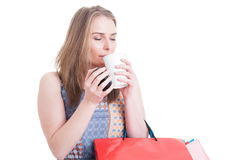 Beautiful woman shopper enjoying the smell of a fresh coffee Royalty Free Stock Photos