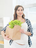 Beautiful woman with a shopping bag with lettuce Stock Photo