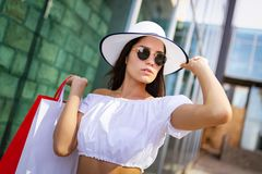 Beautiful woman with shopping bag. Sale, shopping, tourism and happy people concept royalty free stock images