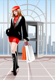 Beautiful Woman With Shopping Bags. Young attractive woman walking with shopping bags Stock Photo