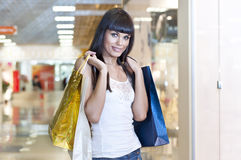 Beautiful woman with shopping bags. In the mall Stock Photos