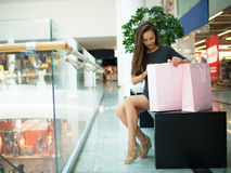 Beautiful woman with shopping bags in big mall. Royalty Free Stock Photos