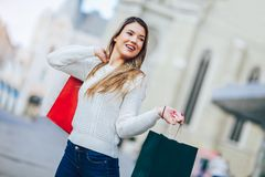 Beautiful woman with shopping bags. In the city Royalty Free Stock Photography