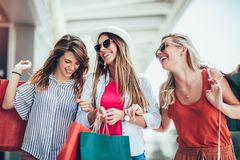 Woman with shopping bags in the city-sale, shopping, tourism and happy people concept. Beautiful women with shopping bags in the city-sale, shopping, tourism and royalty free stock photos