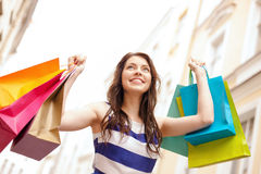 Beautiful woman with shopping bags in the ctiy Royalty Free Stock Photo