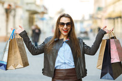 Beautiful woman with shopping bags in the ctiy Royalty Free Stock Image