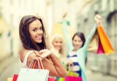 Beautiful woman with shopping bags in the ctiy Royalty Free Stock Images