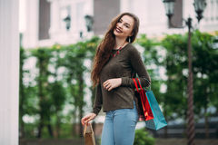 Beautiful woman with shopping bags in ctiy Stock Photography