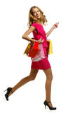 Beautiful woman with shopping bags and gift boxes Royalty Free Stock Images