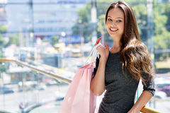 Beautiful woman with shopping bags -indoor royalty free stock photography