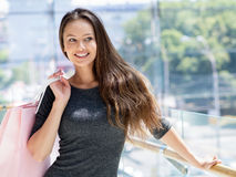 Beautiful woman with shopping bags -indoor stock photo