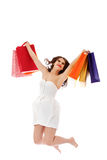 Beautiful woman with shopping bags jumping Stock Image