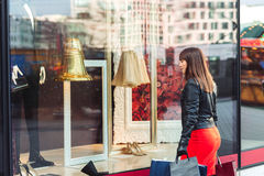 Beautiful woman with shopping bags looking at the shop window Stock Images