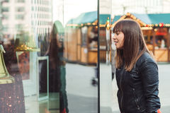 Beautiful woman with shopping bags looking at the shop window Stock Photography