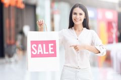 Beautiful woman with shopping bags at mall. Black Friday. Sale. Consumerism concept Royalty Free Stock Image