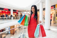 Beautiful woman with shopping bags at the mall Royalty Free Stock Images