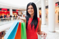 Beautiful woman with shopping bags at the mall Stock Image
