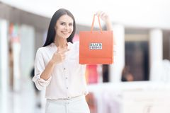 Beautiful woman with shopping bags in mall. Black Friday. Consumerism concept Stock Photo