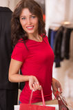 Beautiful Woman with Shopping Bags in Shopping Mall. Shopping Girl Portrait. Beautiful Woman with Shopping Bags in Shopping Mall. Shopper. Sales. Shopping Center Stock Photos