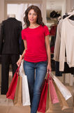 Beautiful Woman with Shopping Bags in Shopping Mall. Shopping Girl Portrait. Beautiful Woman with Shopping Bags in Shopping Mall. Shopper. Sales. Shopping Center Royalty Free Stock Photo