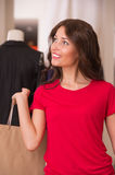 Beautiful Woman with Shopping Bags in Shopping Mall. Shopping Girl Portrait. Beautiful Woman with Shopping Bags in Shopping Mall. Shopper. Sales. Shopping Center Royalty Free Stock Image