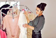 Beautiful woman shopping in the boutique Royalty Free Stock Photography