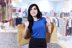 Beautiful woman in shopping centre Stock Images