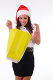 Beautiful woman shopping for Christmas Stock Images