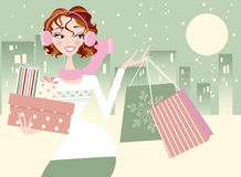 Beautiful Woman Shopping in the City in Winter Royalty Free Stock Photos